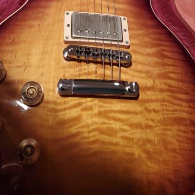 Left handed.Gibson Les paul standard plus 2013Sunburst.