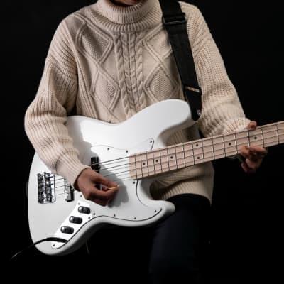 Glarry GJazz Ⅱ Upgrade Electric Bass Guitar with Wilkinson Pickup,Warwick Bass Strings,Bone Nut 2020s White for sale