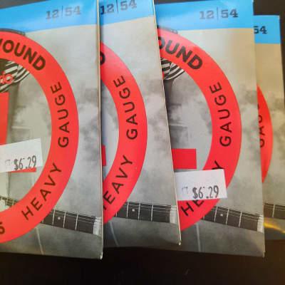 D'Addario EXL145 Nickel Wound Electric Guitar Strings, Heavy Gauge (pack 0f 4)