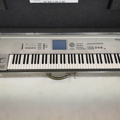 Korg Triton Pro 76 with flight case