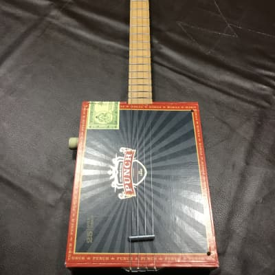 2009 St. Blues Cigar Box Guitar. Punch