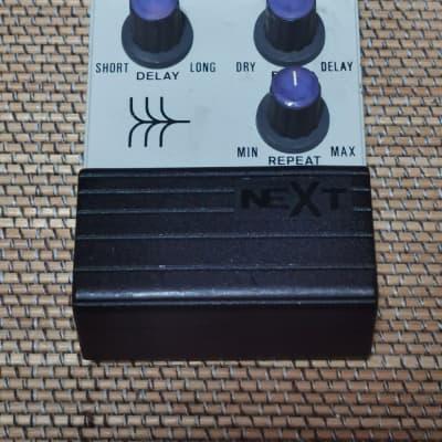 NEXT analog delay 1980