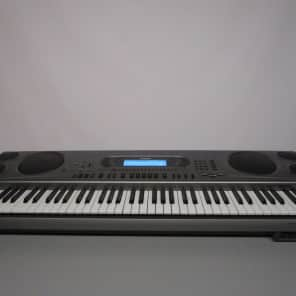 Casio WK-1800 76-Key Touch-Sensitive Portable Keyboard with Floppy Drive