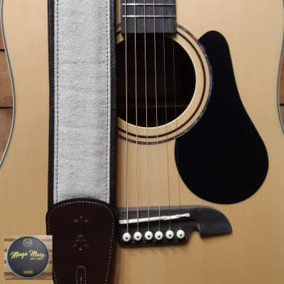 Levy's MHG7 2 1/2″ natural hemp guitar strap with  dark brown garment leather.