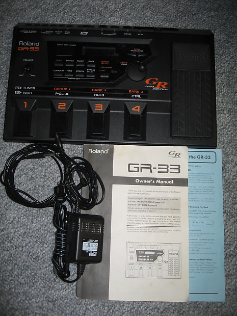 Roland gr-33 guitar synth with gk-2 pickup, cable and manuals.