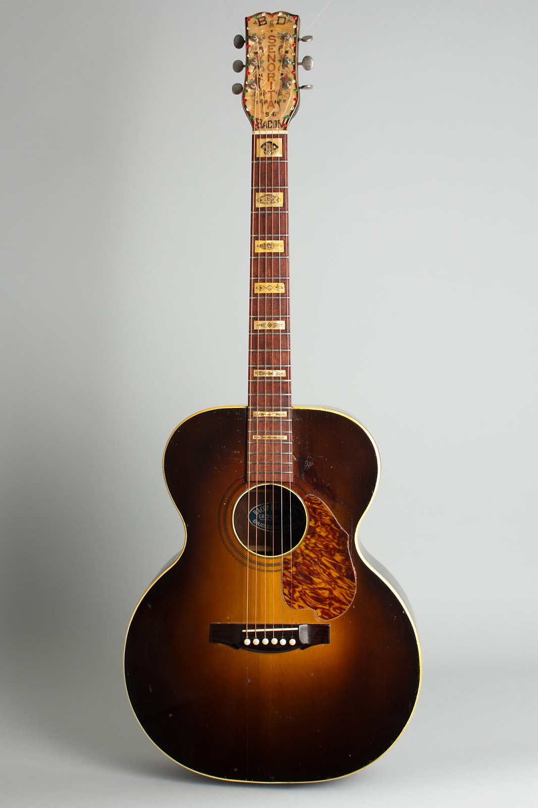 Bacon & Day  Senorita S-6 Previously Owned by Steely Dan's Walter Becker Flat Top Acoustic Guitar (1935), ser. #1019, black hard shell case.