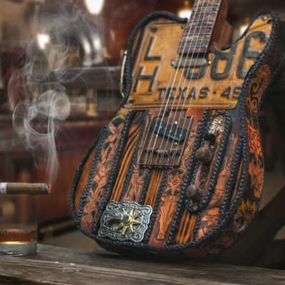 The Cattlecaster- Hand-Tooled Leather Bound Texas Telecaster