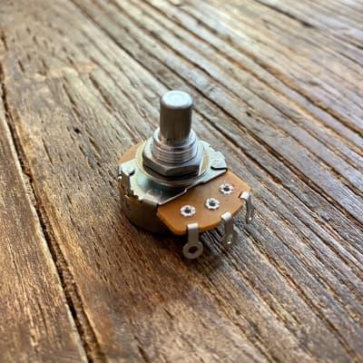 "Alpha Potentiometer | 3/8"" Bushing / .25"" Solid Shaft - 100 kΩ Audio Taper"