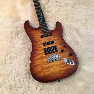 2005  Fender American Deluxe Stratocaster QMT HSS with Ebony Fretboard  Tobacco Sunburst