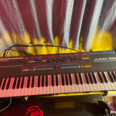 Roland Juno-106 Polyphonic Analogue Synth - voice chips serviced, wood side panels, Pelican case