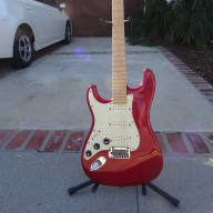 <p>Used Left Handed Fender Straocaster Deluxe American Deluxe Stratocaster Translucent Red</p>  for sale