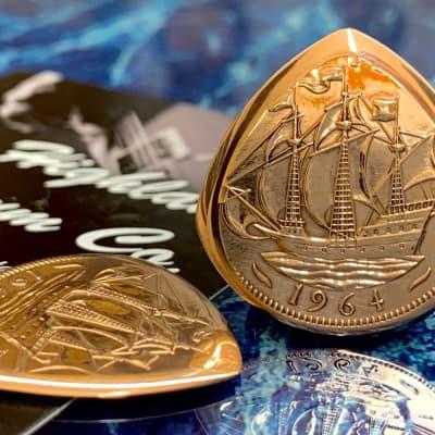The Highland Plectrum Co. One Queen Elizabeth 1964 Bronze Half Penny Coin Plectrum.