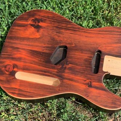 Buren's Fancy Series Light Knotty Pine Tele Body (Tonebomb, CAN) in Diabolical Orange w/Faux Binding