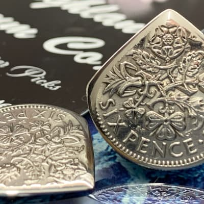 Special Offer. 25% Off Regular Price. Two (2) Queen Elizabeth Sixpence Coin Plectrums.