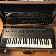 Korg Delta DL-50. Nearly new condition with dust cover, case, manual, and overlays.