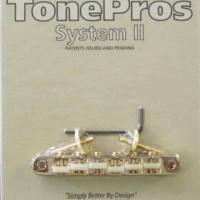 """TonePros AVR2G-G Tuneomatic Bridge with G Formula Nylon """"66"""" Saddles Gold"""