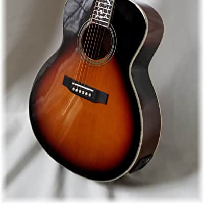 $900 Acoustic / electric( Parlor size )  in 3 Tone Sunburst( Last one ) Tiny chip for sale