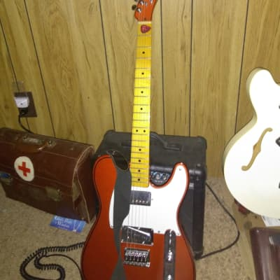 A Beautiful Fender Custom  Tele. With A Custom Finish And Gibson Humbucker Pickup. 2015 Nice Orange Finish With Special Wiring. With Black Piping, Very Beautiful! Big Rock And Roll Frets!<br /> One Small Ding In The Finish Back By The Rear Strap Pin. for sale