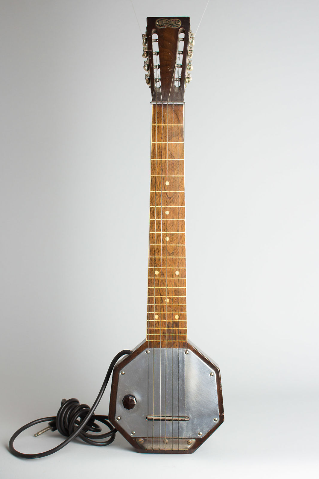 Audiovox  7-String Lap Steel Electric Guitar,  c. 1935, ser. #2369, original black hard shell case.