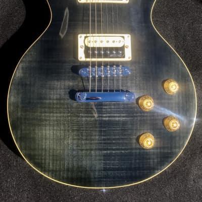 Vintage V100TBK Reissue Trans Black Flame Top Les Paul Style Electric Guitar B Stock