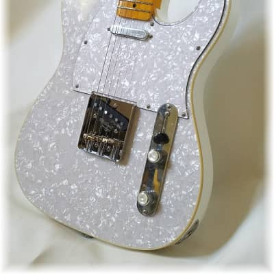 Dillion Tell-E  covered in White pearloid for sale