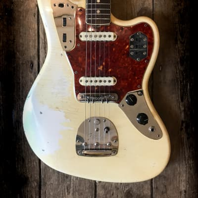 1966 Fender Jaguar in Olympic White with matching headstock & hard shell case