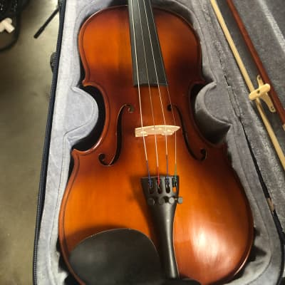 Violin with bow, case, and rosin