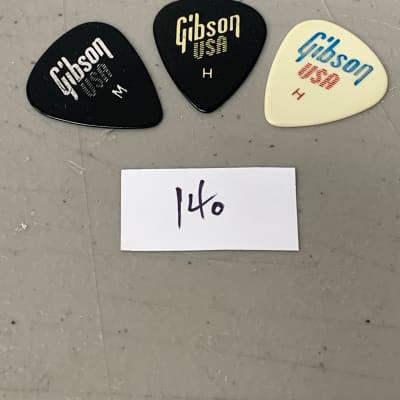 (3) Three Gibson USA Guitar Picks Vintage 1980's Case Candy (140)