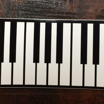 AIM Piano Keyboard Bumper Sticker 2012