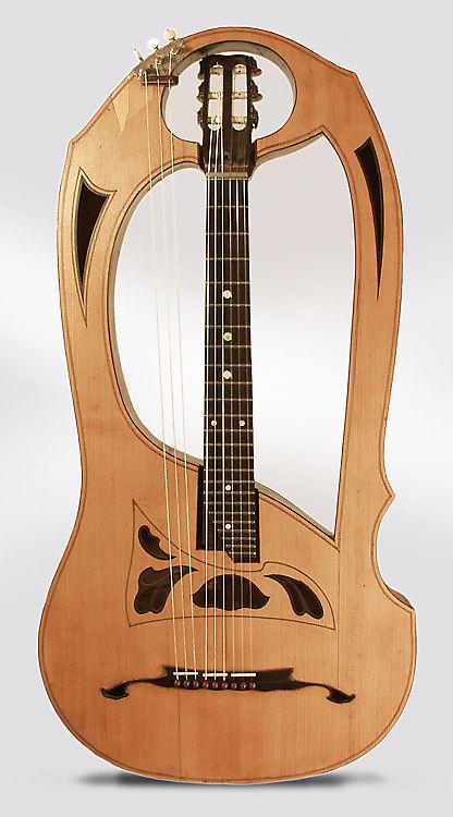 Luigi Mozzani  Lyre Harp Guitar,  c. 1905, ser. #111, black hard shell case.