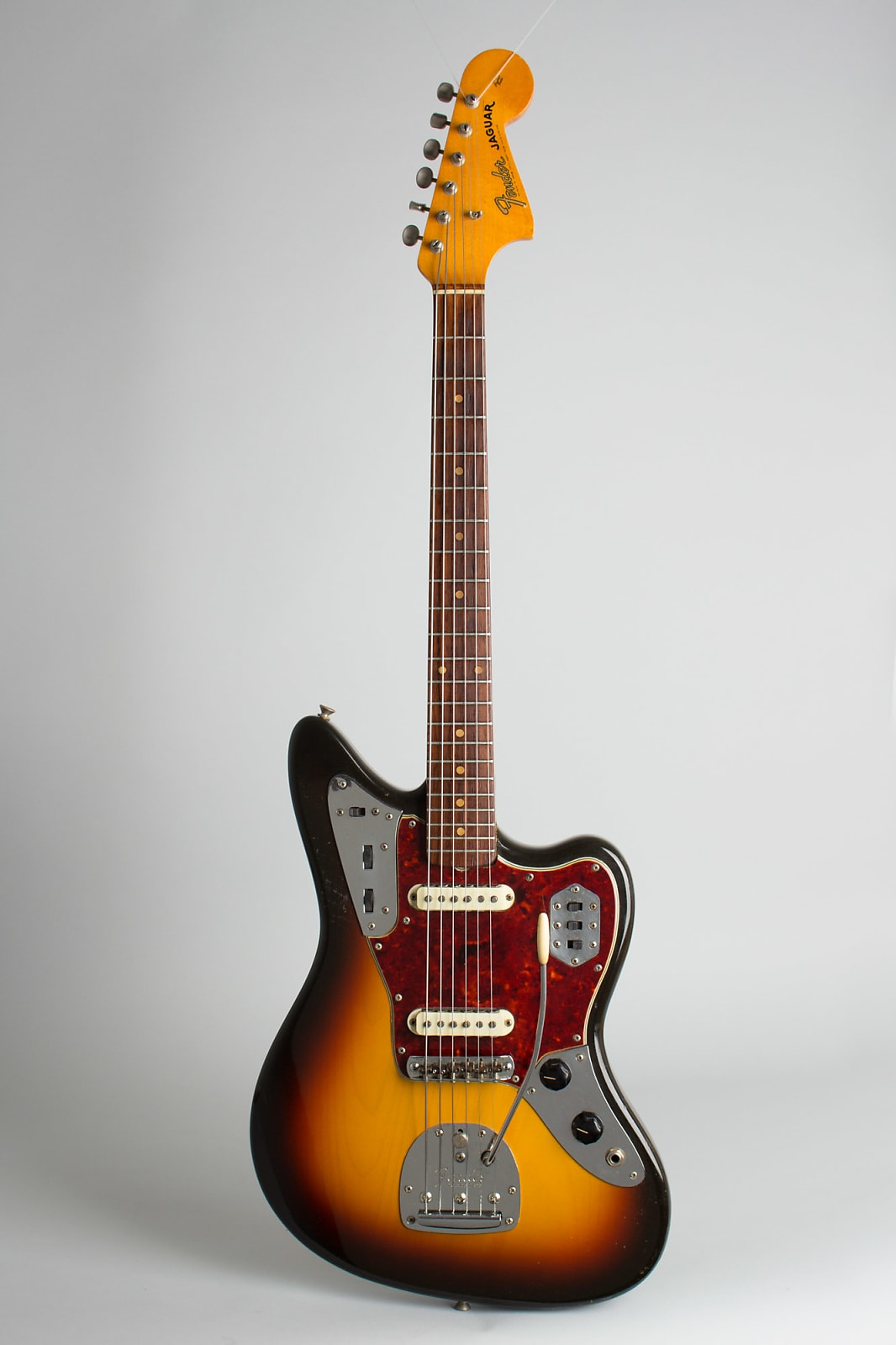 Fender  Jaguar Solid Body Electric Guitar (1964), ser. #L-32632, original brown tolex hard shell case.