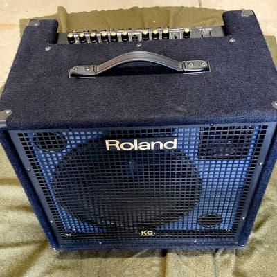 """Roland KC-550 4-Channel 180-Watt 1x15"""" Keyboard Combo 2002 - 2021 Black with Blue speaker housing"""