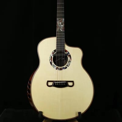 Merida Extrema Chance cutaway solid Spruce/Rosewood Acoustic electric guitar for sale