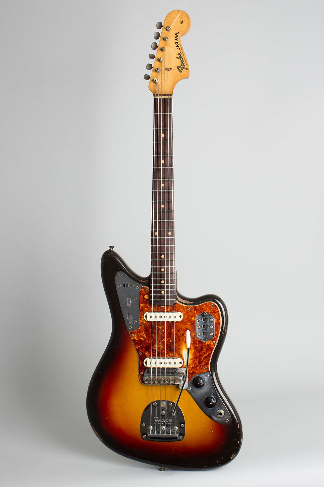Fender  Jaguar Solid Body Electric Guitar (1962), ser. #82135, original brown tolex hard shell case.