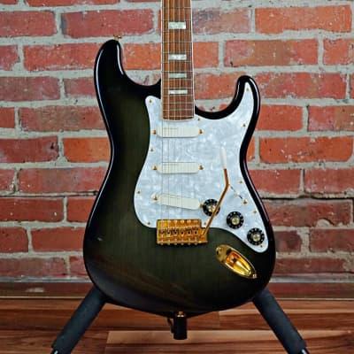 Fender Limited Edition 50th Anniversary Ventures Stratocaster  1996 Transparent Black Burst for sale