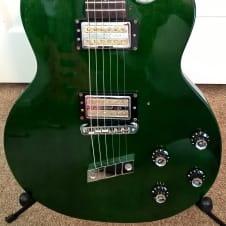 Guild DeArmond M-70 -- Korean; 1999; Transparent Green; Exc Cond; USA Gold-Tone PUs; w/ Gig Bag