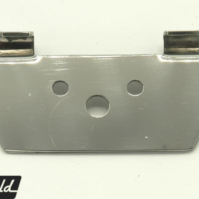 The original adapter bracket to swap Rickenbacker R tailpiece for trapeze