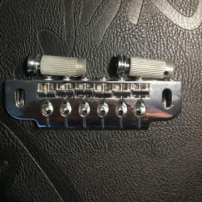 Gotoh 510UBCX Stud Mountable Wrap Around Tailpiece Bridge for sale