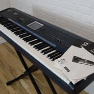 Korg Triton Extreme 88 keyboard synthesizer near MINT-used 88 key piano for sale