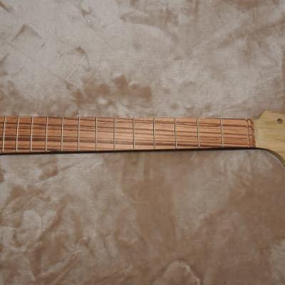 "Strat Style Unfinished Neck Zebrawood on Korina/Limba 22 Medium Tall Frets C Profile 10"" Radius"