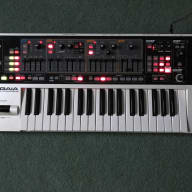 Roland Gaia synth with power source