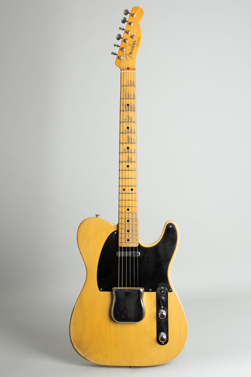 Fender  Telecaster Solid Body Electric Guitar (1952), ser. #2680, original brown hard shell case.