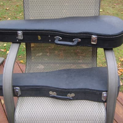 Two Violin Cases - one new, one used