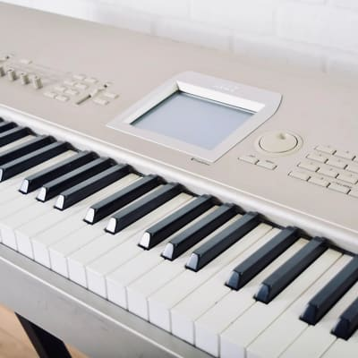 Korg Triton Studio 88 keyboard synthesizer with manuals in excellent cond.