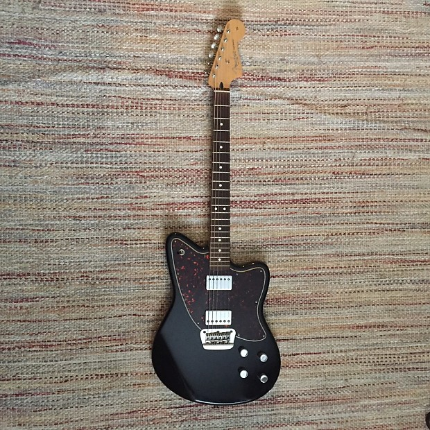 Fender toronado deluxe black 2003 reverb follow this product to see new listings in your feed sciox Choice Image