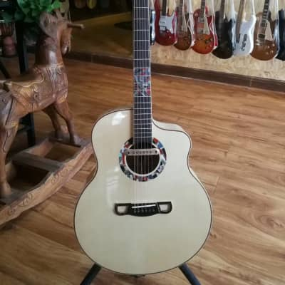 Merida Extrema Chance cutaway solid Spruce/Maple Acoustic electric guitar for sale
