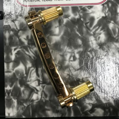 Allparts TP-3445-002 METRIC ECONOMY STOP TAILPIECE Gold