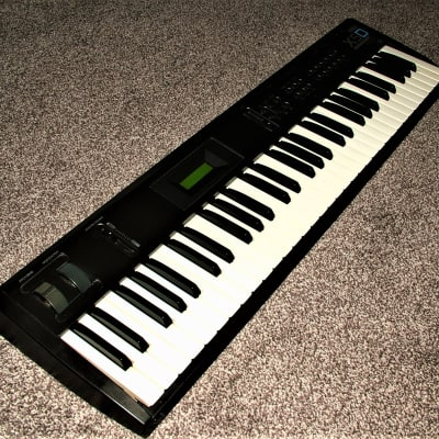 Korg X5D in original packaging, with factory DC power pack and manual.
