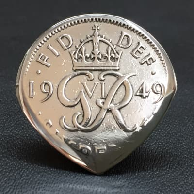 The Highland Plectrum Co. One Brian May Inspired 1949 Sixpence Coin Plectrum.