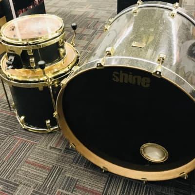 Shine Custom Drums Shine Custom Drums Custom 2005-2007 Black sparkle wrap, gold hardware 2005-2007 B